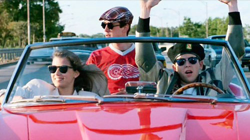 Ferris Bueller and friends riding in a convertible with Ferris at the wheel