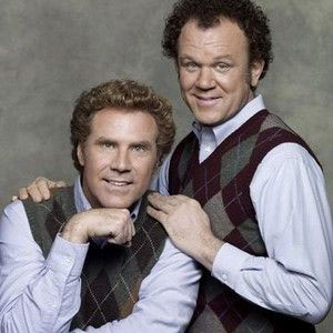 Brennan Huff (Will Ferrel) and Dale Doback (John C. Reilly) standing together in an awkward family portrait