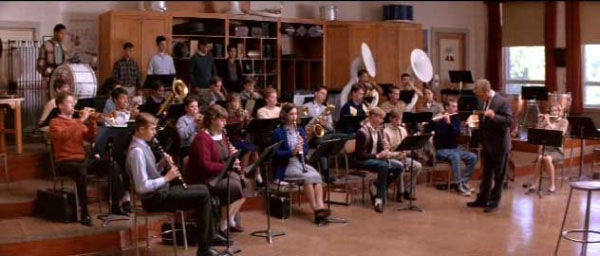 Students in a school band holding various instruments in Mr. Holland's Opus